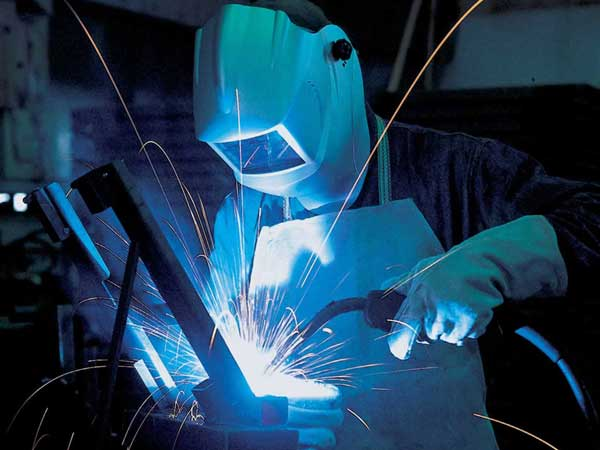 Man welding with MIG welder