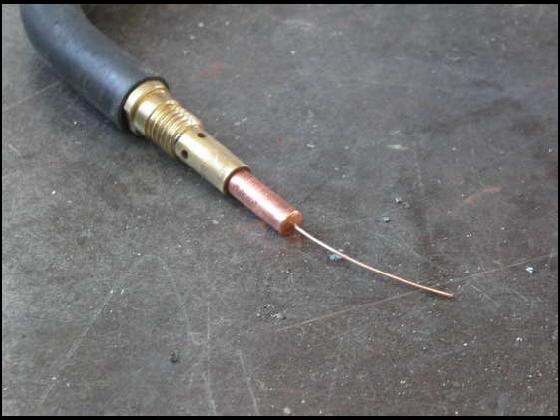 Screw tip on MIG welding torch